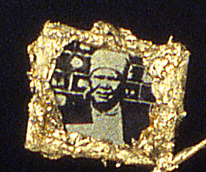 Necklace (detail-family)-Images of the family the miners left to work in the mines