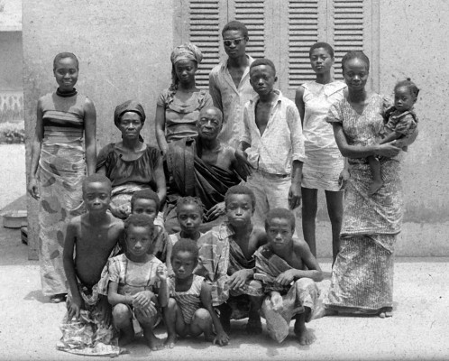 Janet's homestay family in Kyekyewere, Ghana. Seated are the chief and his wife. The man standing in the back with sunglasses was her host.