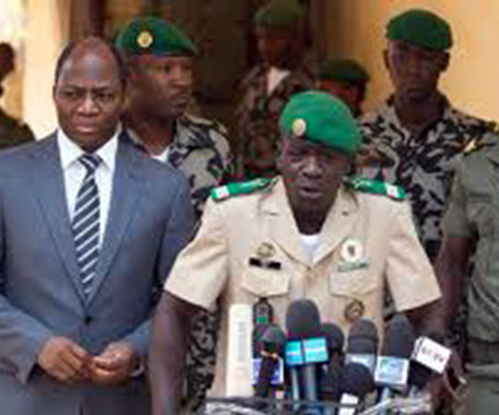 Amadou Haya Sanogo, the leader of the mutiny accompanied by Djibril Bassole, the Burkina Faso Foreign Affairs Minister.