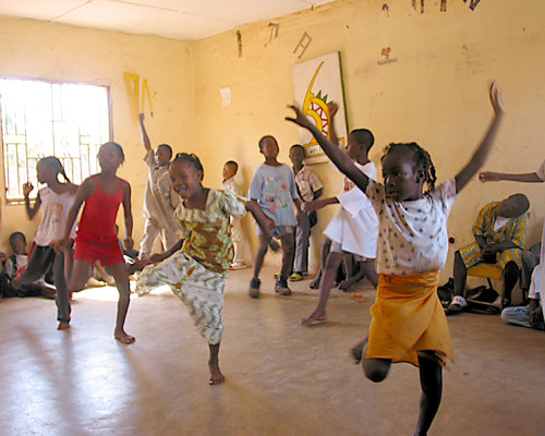 CHILDREN dancing at school.